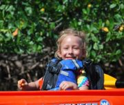 Child enjoying her kayak ride
